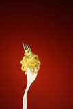 Noodle and fork Stock Images
