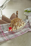 Noodle Ice Cream. Ice cream shaped like noodles with mixed nuts, chocolate milk, and some other toping Stock Image