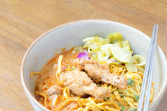 Noodle Khao soi , Thai food. On wood background Royalty Free Stock Photography