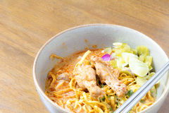 Noodle Khao soi , Thai food. On wood background Stock Photos