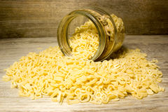 Noodle letters and glass jar Royalty Free Stock Images