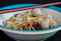 Noodle with meat ball. A delicious noodle with meat ball ,with chopstick stock photo