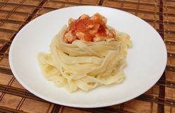 Noodle nests with chicken in tomato Royalty Free Stock Photo
