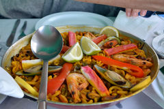 Noodle paella with seafood a bowl on a table. Stock Photo