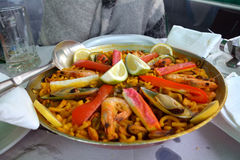 Noodle paella with seafood a bowl on a table. Stock Photography