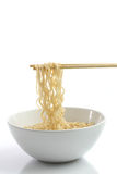 Noodle with pinch by chopsticks Royalty Free Stock Photo