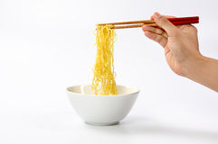 Noodle with pinch chopsticks Royalty Free Stock Photos