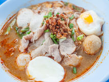 Noodle with pork and egg. Hot and sour soup noodle with pork and egg Stock Photos