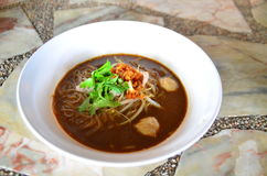 Noodle with pork. In white bowl on the table Royalty Free Stock Images