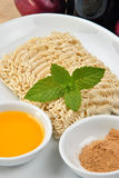 Noodle and some flavour powder Royalty Free Stock Photos