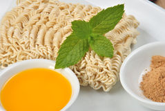 Noodle and some flavour powder Stock Photos