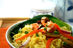 Noodle soup. Close up of a bowl of egg noodles with shrimp and veggies stock images