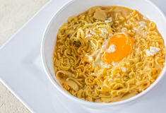 Noodle soup with egg on white plate Royalty Free Stock Photography