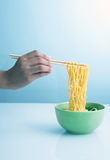 Noodle soup with hand holding chopsticks Royalty Free Stock Photography