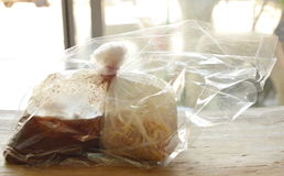 Noodle and soup packing in plastic bag for take home Royalty Free Stock Photos