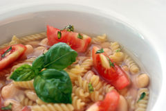 noodle soup with white beans and tomato Royalty Free Stock Images