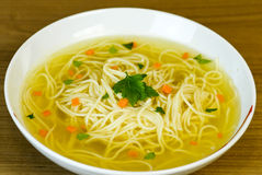 Noodle soup in white bowl Stock Image