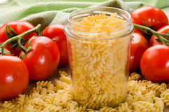 Noodle in a storage glass and tomato Royalty Free Stock Photo