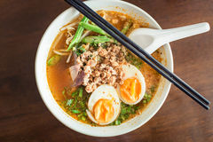 Noodle Tom Yam, hot spicy soup served with boiled egg. Thai cuisine : Noodle Tom Yam, noodles with vegetable pork and hot spicy soup served with boiled egg Royalty Free Stock Images