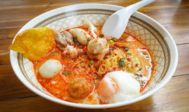 Noodle Tom yum seafood put egg. Stock Photo