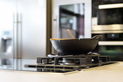 Noodle wok on gas stove on workplate Stock Image