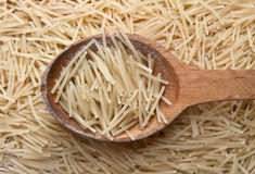 Noodles. In a wooden spoon Stock Images