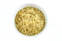 Bowl of Curly Noodles. Isolated bowl of plain cooked curly noodles royalty free stock images