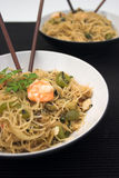 Noodles!. Bowls of vermicelli noodles with king prawns & chopsticks Royalty Free Stock Photography