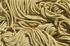 Noodles. Close-up of dried,uncooked,chinese egg noodles stock photos