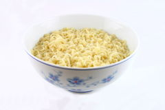 Bowl of noodles. A bowl of cooked noodles stock images