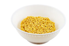 Noodles. In a bowl before water is added, isolated on white background Stock Image