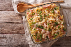 Noodles baked with ham and cheese close-up in a baking dish. hor Royalty Free Stock Photography