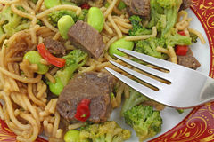 Noodles beef and vegetables with fork Stock Photos