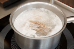 Noodles being cooked in boiling water Stock Photos