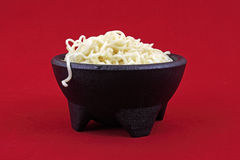 Noodles in black bowl Royalty Free Stock Photos
