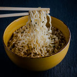 Noodles on black Stock Image