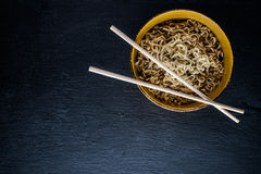 Noodles on black Stock Photos