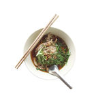 Noodles with boiled pork in a bowl on white background. Stock Image