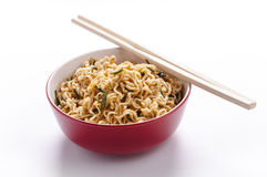 Noodles. In bowl and chopsticks royalty free stock images