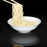 Noodles in the bowl with chopsticks Stock Image