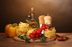 Noodles in bowl, jar of oil, spices Royalty Free Stock Images