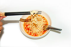Noodles in a bowl on a white background Stock Image