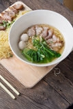 Noodles bowl on wooden background Royalty Free Stock Photos