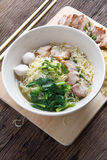 Noodles bowl on wooden background Royalty Free Stock Photo