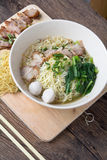 Noodles bowl on wooden background Royalty Free Stock Photography