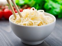 Noodles in a bowl Stock Images