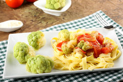 Noodles with broccoli, bacon and tomato Stock Image