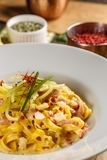 Noodles with cheese and prosciutto stock image