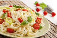 Noodles. With cherry tomatoes, green pepper and basil stock photography