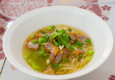 Noodles, Chinese egg noodles with red pork in hot soup Royalty Free Stock Images